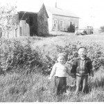 Dad and Uncle Richard in front of Grampie&#039;s house in the 1940s
